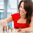 Business woman sitting in front of chess — Stock Photo #71469773