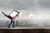 Guy carrying laptop — Stock Photo