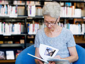 Taking her time with new books — Stock Photo