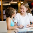 Teenage girl and her brother with books — Stockfoto #74580309