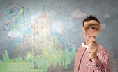 Guy looking in magnifying glass — Stock Photo
