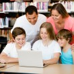 Family in library — Foto de Stock   #76895363