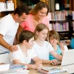 Family in library — Foto de Stock   #76958617