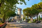 The Italian town of Sirmione. At the center of the frame-famous castle of Scaliger. Summer 2013 — Stock Photo