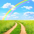Rural landscape with old road and rainbow — Stock Photo #63458683