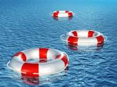 Three lifebuoys, floating on waves — Stock Photo