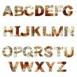 Alphabet - letters from rusty metal with rivets — Stock Photo #68446617