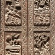 Wooden door with scenes from life of Buddha, Kathmandu, Nepal — Stock Photo #71406967