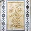 Ancient carved flower on marble in Amber Fort, Jaipur, Rajasthan — Stock Photo #71933991