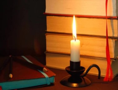 Candle fire and notebook for writer. — Stock Video