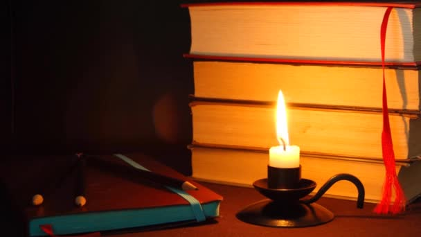 Candle fire and notebook for writer. — Vídeo de stock
