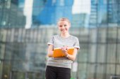 Smiling young woman with notebook — Stock Photo
