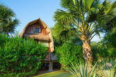 Wooden bungalow on a tropical beach resort on Bali — Stock Photo