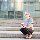 Young woman having her coffee break outside — Stock Photo