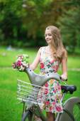 Beautiful girl with bicycle in the countryside — Foto Stock