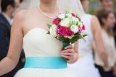 Bride holding beautiful wedding bouquet — Stock Photo