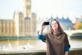 Tourist in London doing selfie — Stock Photo