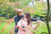 Dating couple in park on a fall day — Foto de Stock