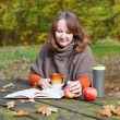 Girl reading a book in park — Stock Photo #58227509
