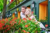 Young couple on a balcony of their house — Stock Photo