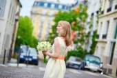Young bride on a street of Montmartre in Paris  — Stock Photo