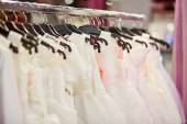 Collection of wedding dresses in a shop  — Stock Photo