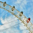 Ferris wheel against a blue sky — Stock Photo #60230341