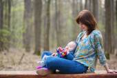Young mother with her baby boy in forest — Stock Photo