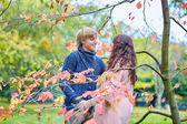 Dating couple in park on a fall day  — Stockfoto