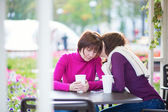 Mother and daughter together in cafe  — Stock Photo