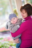 Middle aged woman and her adorable grandson — Stock Photo