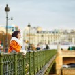 Happy tourist in Paris on a winter or spring day — Stock Photo #60729399