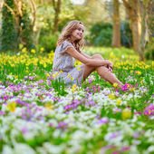 Happy young girl in park on a spring day — Stock Photo