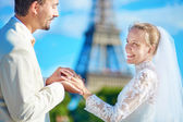 Groom putting wedding ring on a finger of bride  — Stock Photo