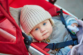 Cute 9 month little boy in a stroller  — Zdjęcie stockowe