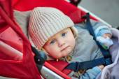 Cute 9 month little boy in a stroller  — Stockfoto