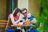 Happy family of three together — Stock Photo