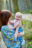 Young mother with her little son on a spring day — Stock Photo