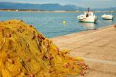 Pile of yellow fishing nets in port — Stock Photo