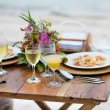 Romantic dinner served for two on a beach — Stock Photo #63604087