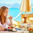 Beautiful young woman in a beach restaurant — Stock Photo #64256887