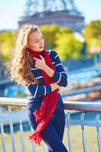 Beautiful girl in red scarf on a fall day in Paris — Stock Photo