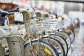 Parisian public bicycles under rain — Stock Photo