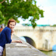 Smiling beautiful young woman in Paris — Stock Photo #64484219