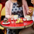Coffee or tea and macaroons in a Parisian cafe — Stock Photo #64486523
