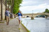 Couple is walking by the Seine — Stock Photo