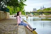 Couple is sitting on the embankment — Stock Photo