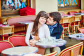 Young romantic couple in a cafe — Stock Photo