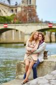 Loving couple in Paris near Notre-Dame cathedral — Stock Photo