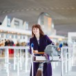 Young female passenger at the airport — Stock Photo #66703715